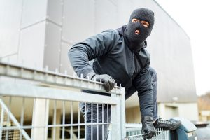 burglar in mask entering business