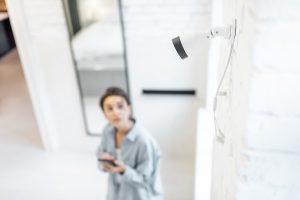 Woman checks home security camera