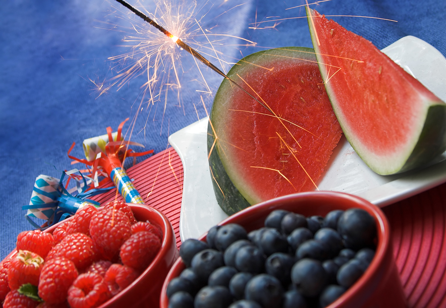 Watermelon, blueberries, and raspberries with 4th of July decorations