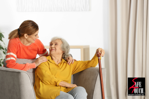 younger woman smiling and putting arms around elderly woman