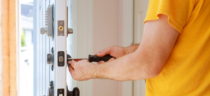 Man changing locks in home