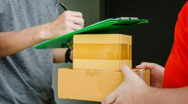 Postman delivering package.