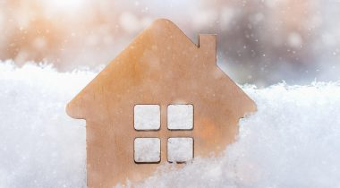 Small wooden home in snow